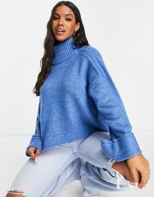 ASOS DESIGN boxy jumper with high neck and turn back cuff in blue £28.00